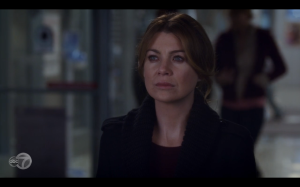 Meredith watching Derek walk away.