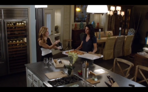 Maura and Jane end the case with French wine and pizza.